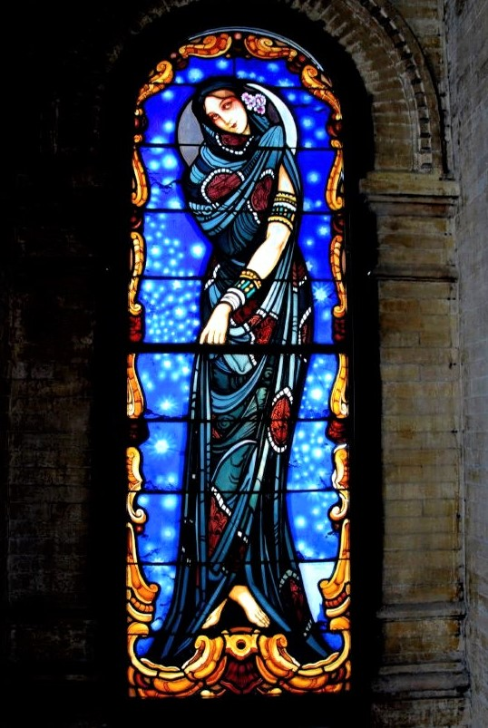 a stained-glass window depicting the Virgin Mary