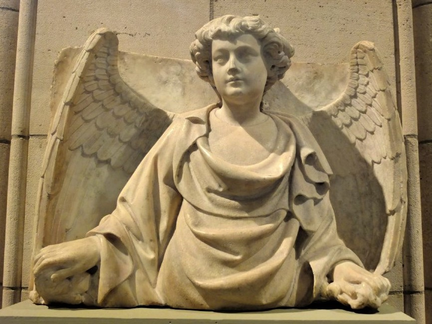 a Medieval stone sculpture of an angel