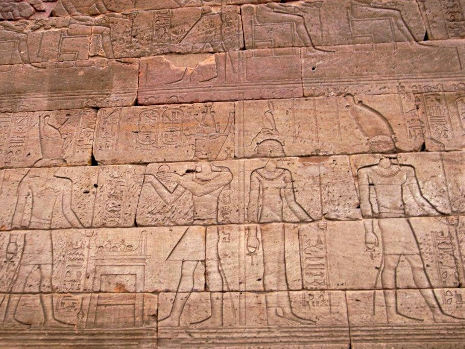 a stone panel covered in ancient Egyptian heiroglyphics