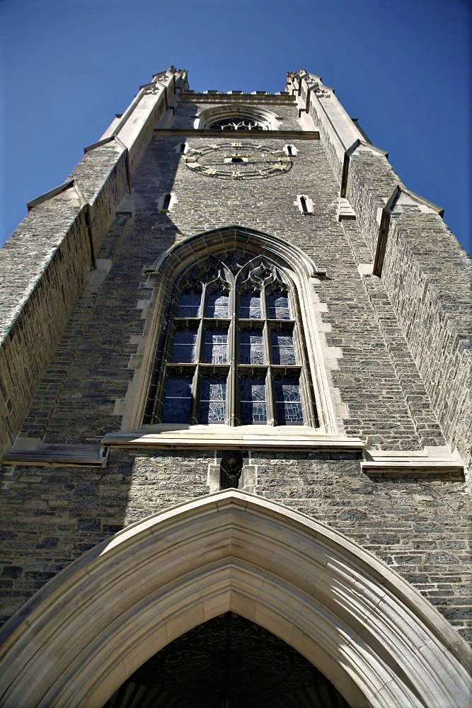 A cathedral tower viewed from its base and looking upward