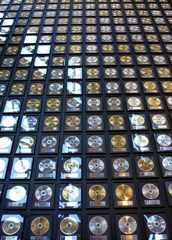 A wall covered in gold and platinum records
