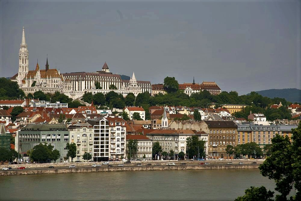 A view of the city of Budapest with the Danube River in the foreground