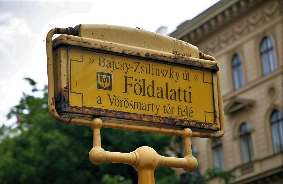 A yellow street sign